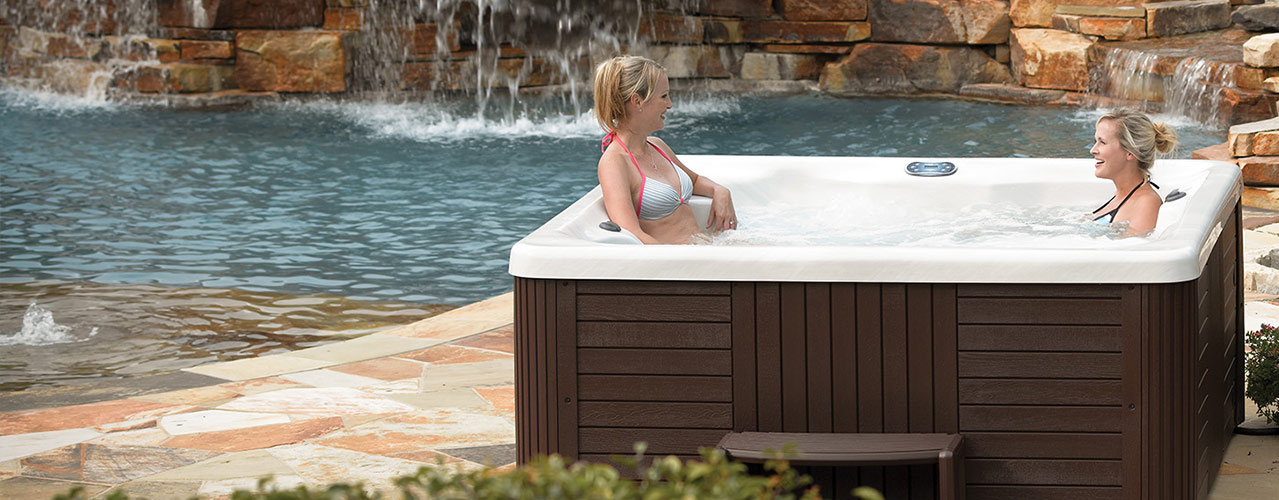 Clarity Spas hot tub on patio by pool